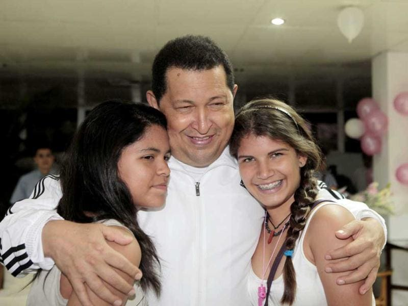 Venezuelan President Hugo Chavez (C) hugging members of his family during the birthday celebration for his daughter Maria Gabriela (not in frame) in Havana. (AFP)