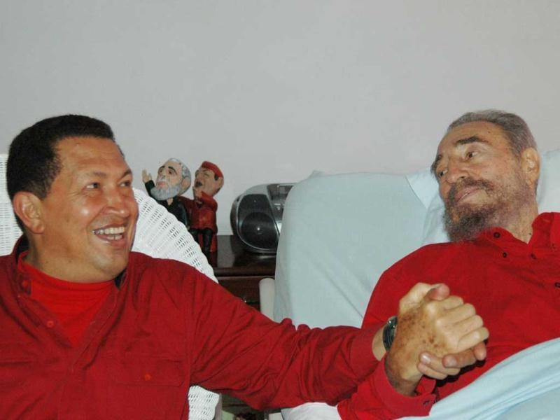 Cuba's leader Fidel Castro, and Hugo Chavez hold hands as Castro recuperates from surgery in Havana, Cuba. (AP)