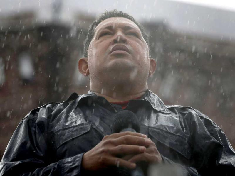 Venezuela's President and presidential candidate Hugo Chavez speaks in the rain during his closing campaign rally in Caracas in this October 4, 2012 file photo. Chavez died on March 5, 2013, after a two-year battle with cancer. (Reuters)