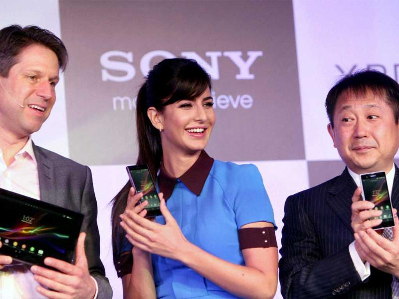 Katrina Kaif with Dennis van Schie, Corporate Vice President of Sony Mobile Communications and Kenichiro Hibi (R), Managing Director, Sony India, during the launch of Sony Xperia Z. Photo: PTI/Subhav Shukla