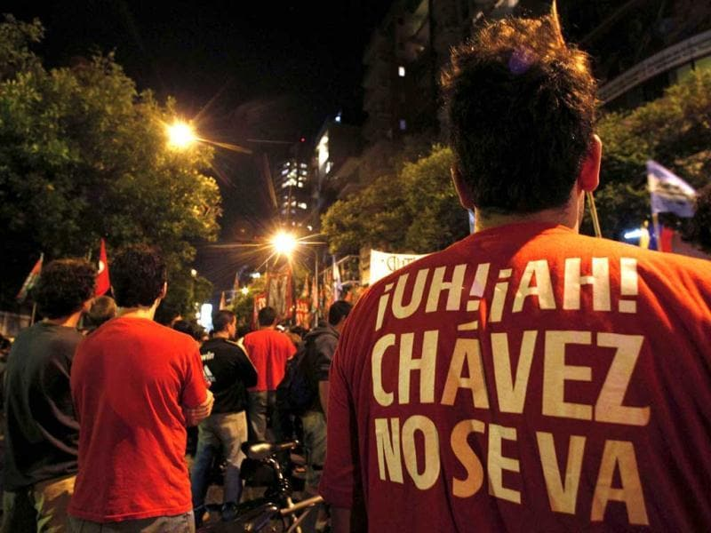 A supporter of Venezuela's President Hugo Chavez wears a t-shirt that reads