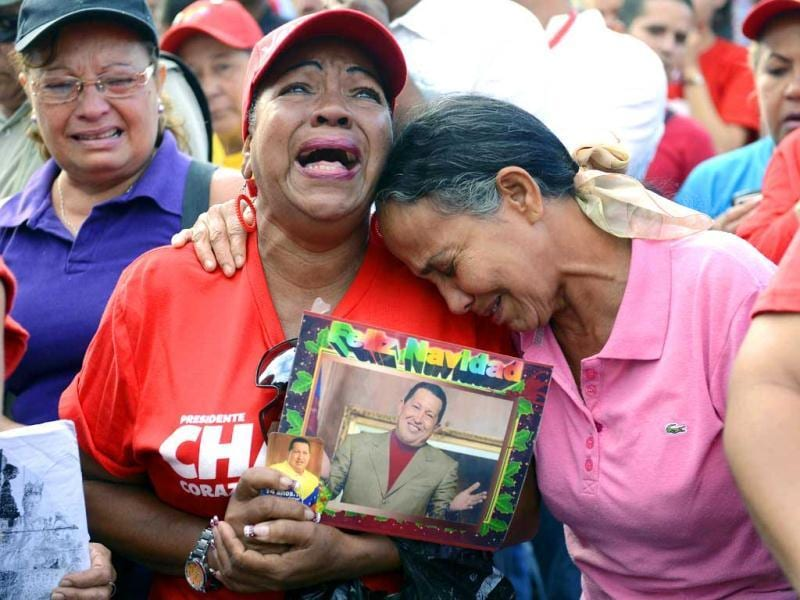 Supporters of the late Venezuelan President Hugo Chavez cry in front of the Military Hospital -- where he had been hospitalized-- a day after his death, in Caracas. AFP photo