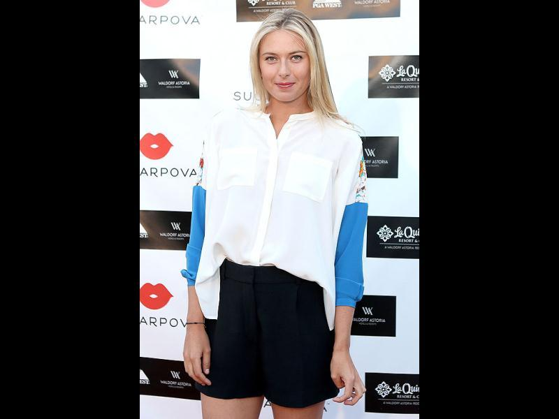 Maria Sharapova of Russia poses for photographers at a Sugarpova Event for her Sugarpova candies held at the La Quinta Resort in La Quinta, California. (AFP)