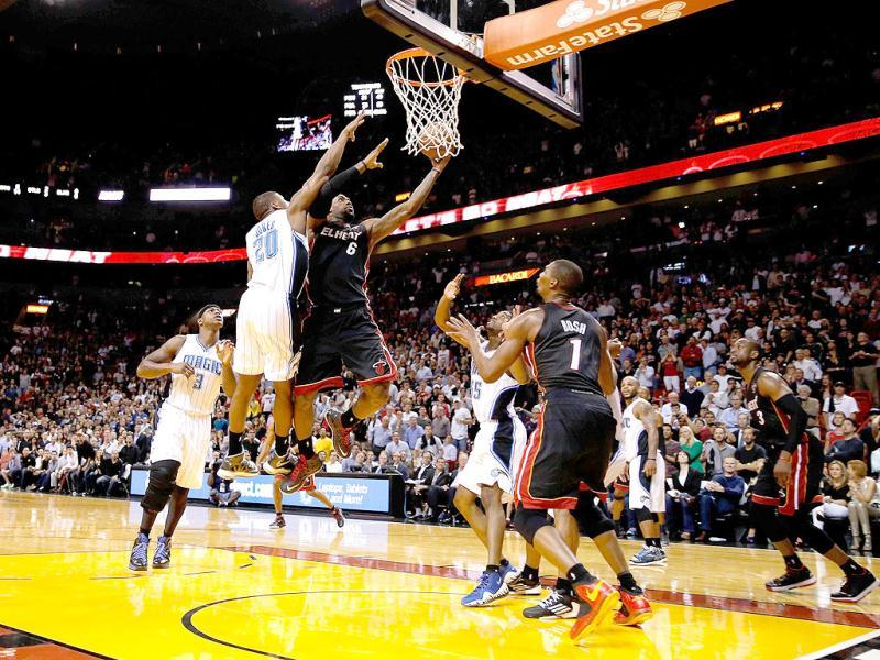 LeBron James #6 of the Miami Heat scores with a driving lay up with 3.2 seconds left in the fourth quarter past DeQuan Jones #20 of the Orlando Magic at American Airlines Arena in Miami, Florida. (AFP)