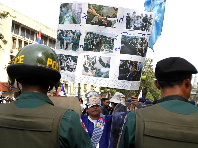 Police officers block a street that Boeung Kak Lake residents are attempting to march along, during a protest held on International Women's Day, in Phnom Penh. (Reuters)