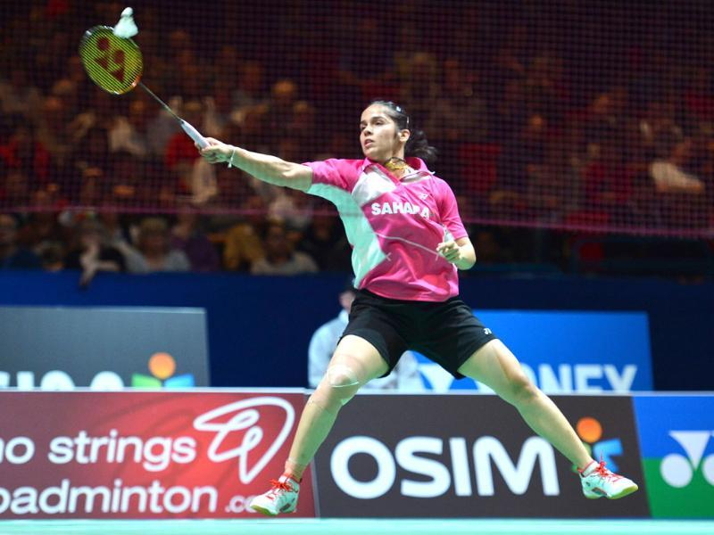 Saina Nehwal returns to China's Wang Shixian during their All England Open Badminton Championships women's singles quarter-final match in Birmingham, central England. AFP/Ben Stansall