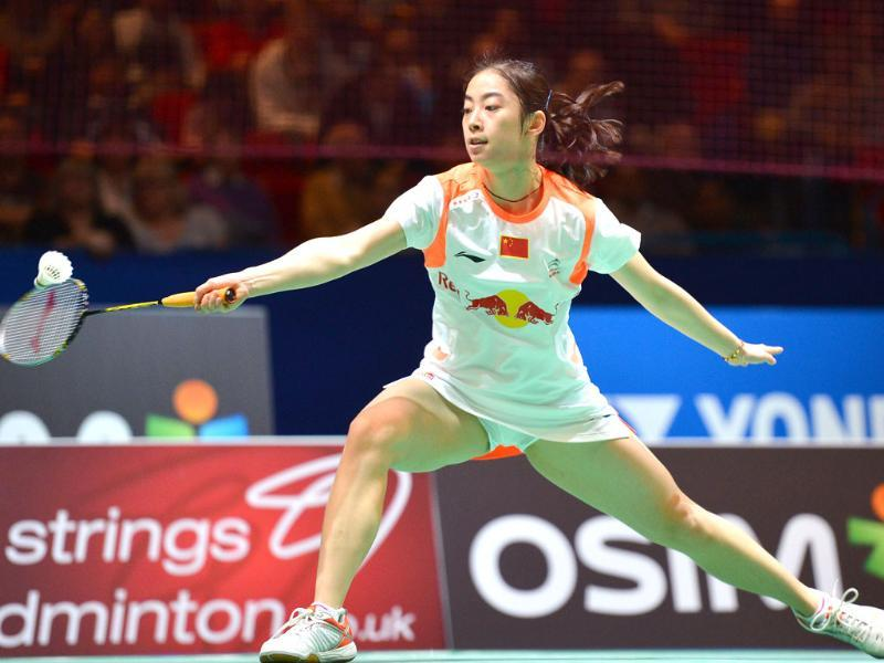 China's Wang Shixian returns to Saina Nehwal during their All England Open Badminton Championships women's singles quarter-final match in Birmingham, central England. AFP/Ben Stansall