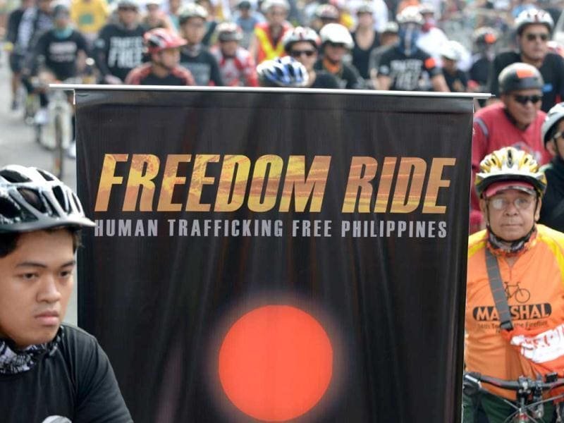Hundreds of cyclists ride along a road on Manila's business district in support of a global campaign against human trafficking. AFP photo