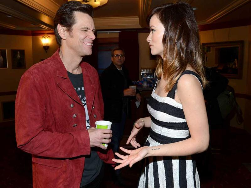 Actor Jim Carrey (L) and actress Olivia Wilde pose in the green room for the screening of