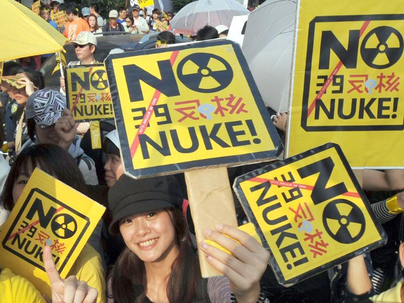 Protesters display various placards during an anti-nuclear demonstration in Taipei. Tens of thousands of Taiwanese people rallied in the capital to demand the government heed the lesson of a Japanese atomic crisis and scrap the island's nuclear facilities, organisers said. AFP/Mandy Cheng