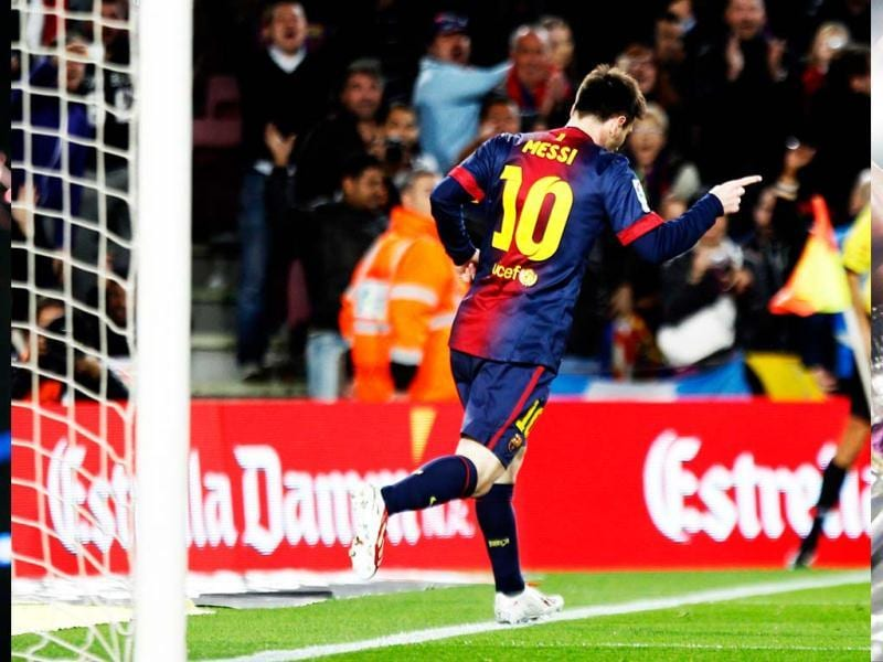 Barcelona's Lionel Messi celebrates scoring a goal against Deportivo during their Spanish first division soccer match at Nou Camp stadium in Barcelona.  (Reuters)