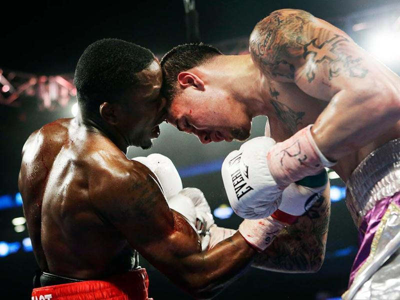 Lonnie Smith (L) punches Michael Perez during the fifth round of a Lightweight boxing match at the Barclays Center in New York. (AP)