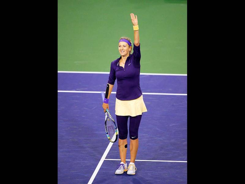 Victoria Azarenka waves to fans after defeating Daniela Hantuchova, of Slovakia, at the BNP Paribas Open tennis tournament in Indian Wells. (AP)