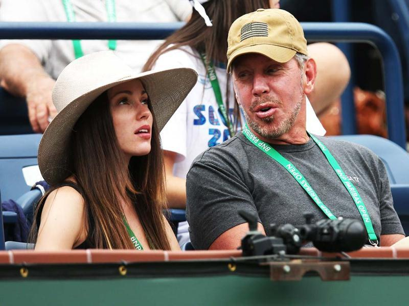 Nikita Kahn and Larry Ellison, tournament owner and CEO of Oracle, attend the match between Roger Federer of Switzerland and Denis Istomin of Uzbekistan during day 4 of the BNP Paribas Open in Indian Wells. (AFP)
