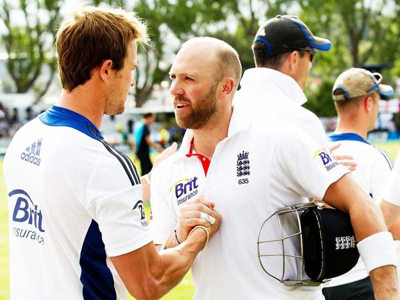 England's batsman Matt Prior (R) shakes hands with team mate Nick Compton at the end of play during day four of the first international cricket Test match between New Zealand and England at the University Oval park in Dunedin. (AFP)