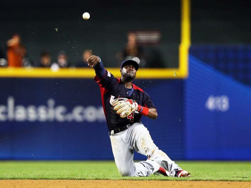 Brandon Phillips #4 of Team USA throws the ball after a diving ground ball in the sixth inning against Team Italy during the World Baseball Classic First Round Group D game at Chase Field in Phoenix, Arizona. (AFP)