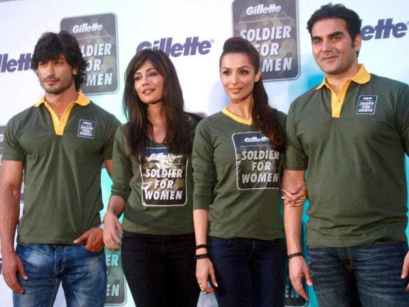 Bollywood stars Vidyut Jammwal, Chitragada Singh, Malaika Arora and Arbaaz Khan at an event on International Women's Day in Mumbai. (PTI Photo)