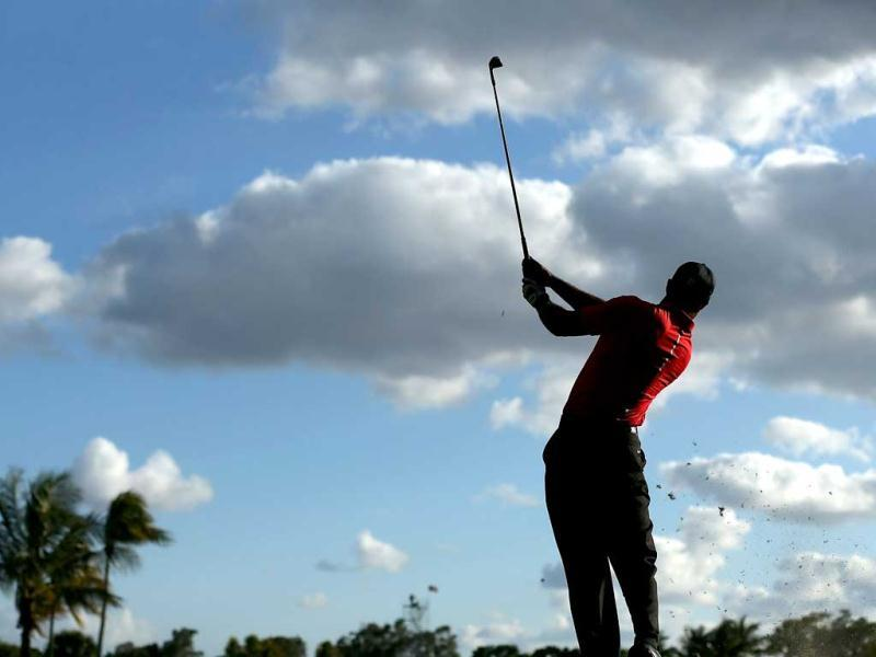 Tiger Woods hits a shot during the final round of the World Golf Championships-Cadillac Championship at the Trump Doral Golf Resort ' + char(38) +' Spa in Doral, Florida. AFP photo