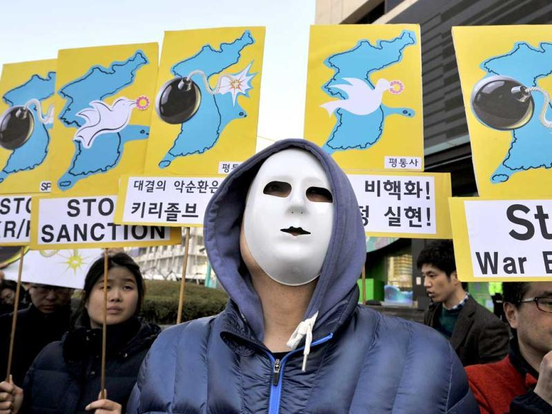 Anti-war activists wearing masks hold placards showing the Korean Peninsula during a protest against a joint military exercise between South Korea and the US, called Key Resolve, near the US embassy in Seoul. AFP photo