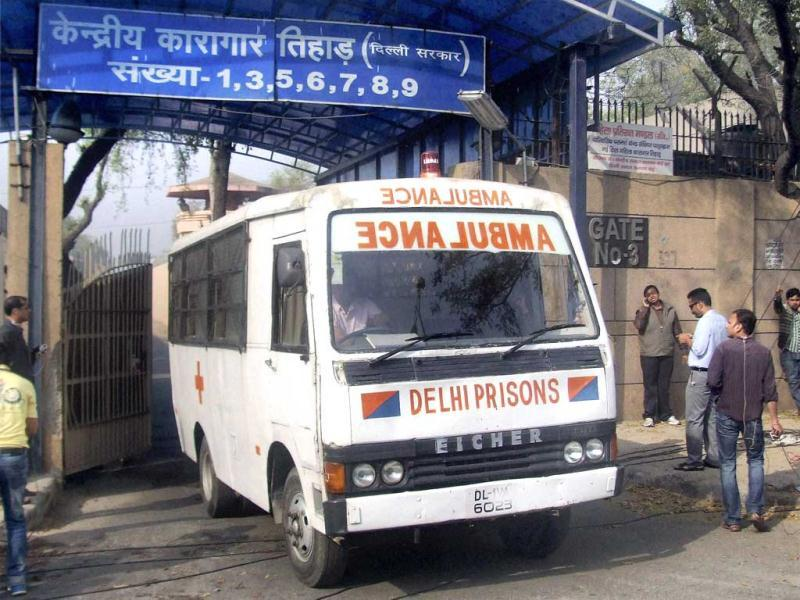 An ambulance comes out of Tihar Jail in New Delhi. Ram Singh, the prime accused in the Delhi gangrape case, allegedly committed suicide at Tihar jail. (PTI Photo)