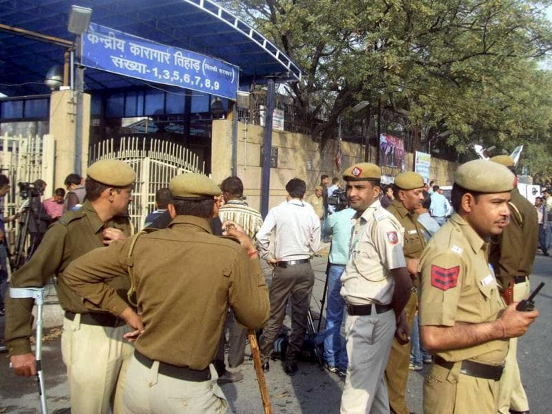 Policemen stand outside Tihar Jail in New Delhi. Ram Singh, the prime accused in the Delhi gangrape case, allegedly committed suicide at Tihar jail. (PTI Photo)