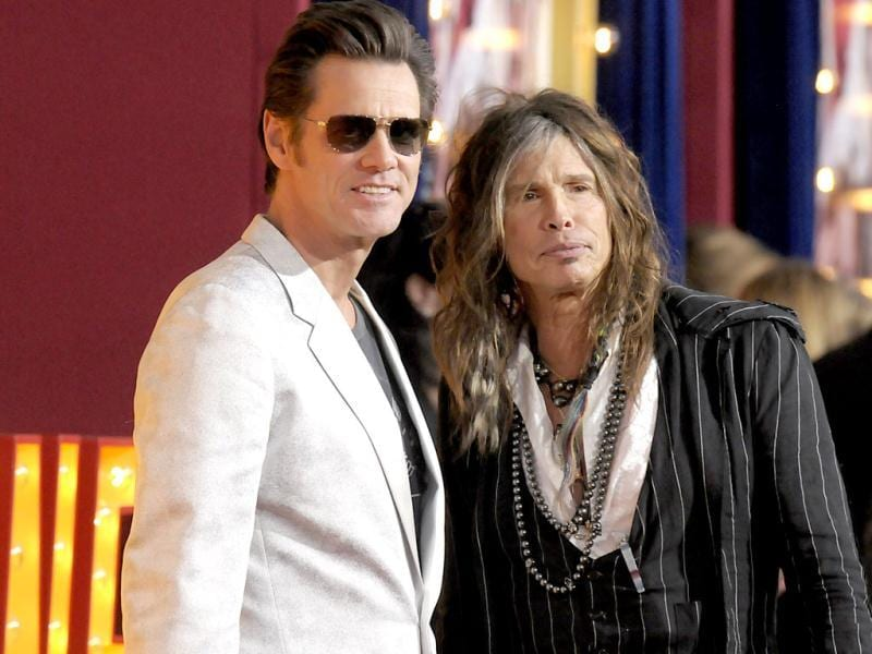Actor Jim Carrey, left, and singer Steven Tyler arrive at the world premiere of the feature film The Incredible Burt Wonderstone at the TCL Chinese Theatre in Los Angeles. AP photo