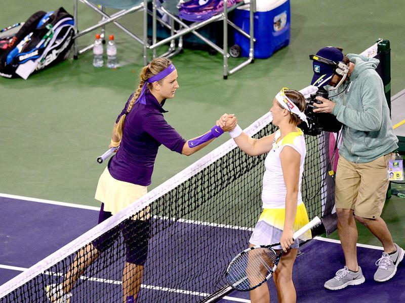 Victoria Azarenka (L) of Belarus greets Kirsten Flipkens (R) of Belgium folowing their WTA third round match at Indian Wells, California. AFP photo