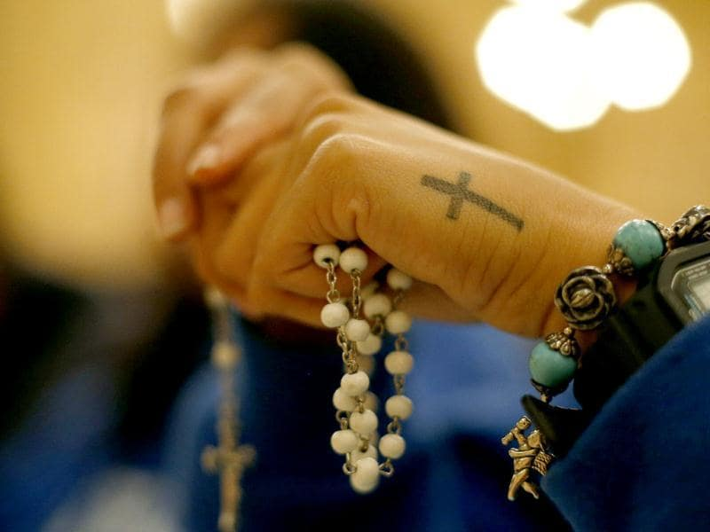 A faithful holds a rosary during a special prayer vigil at the Cathedral of Our Lady of the Angels in Los Angeles. The church will remain open until Tuesday morning for the special prayer vigil as cardinals gather in Rome to elect the new Pope. AP Photo