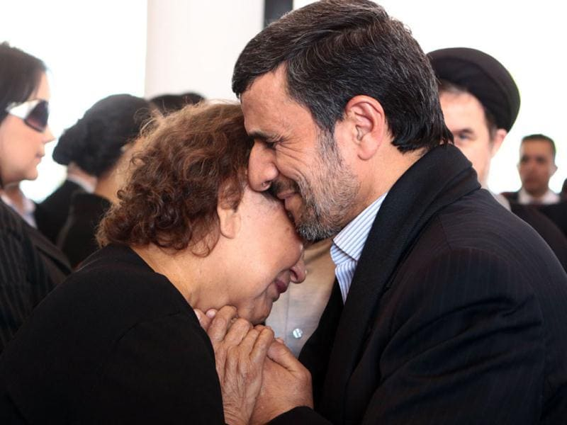 Handout picture released by the Venezuelan presidency press office showing Iran's President Mahmoud Ahmadinejad (R) offering his condolences to the mother of late Venezuelan President Hugo Chavez, Elena Frias, during his funeral in Caracas. AFP photo/Presidencia/HO