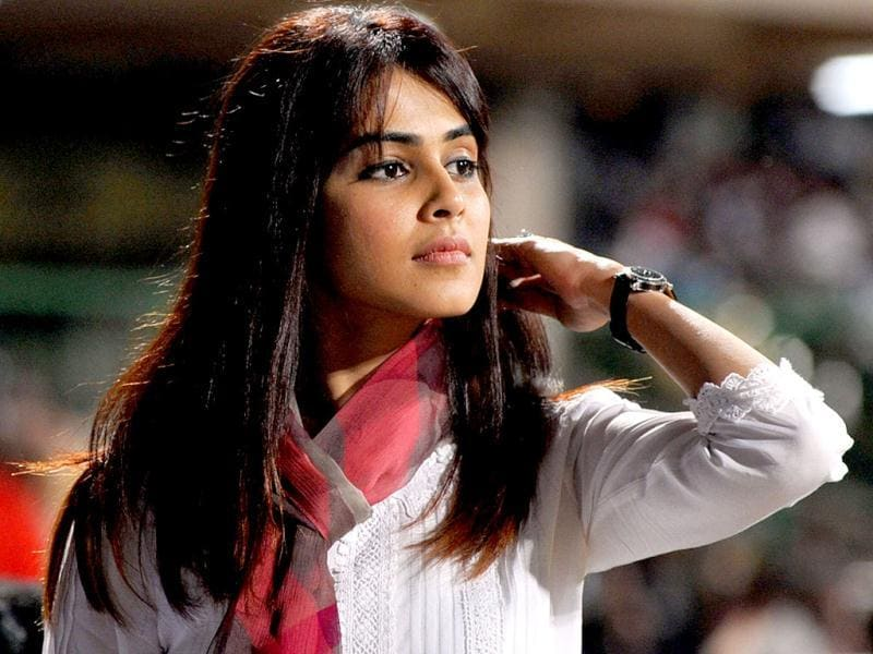 Genelia was seen in a plain white top teamed with a red scarf. (AFP PHOTO)