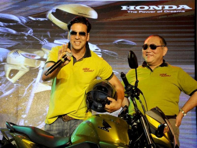 Akshay Kumar and Honda Motorcycles and Scooters India Pvt. Ltd. President and CEO, K Muramastu during the Honda new bike