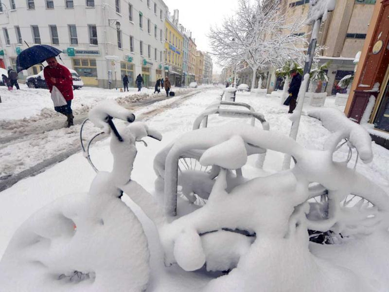 Snow covers bicycles following heavy snowfalls in Cherbourg. (AFP)