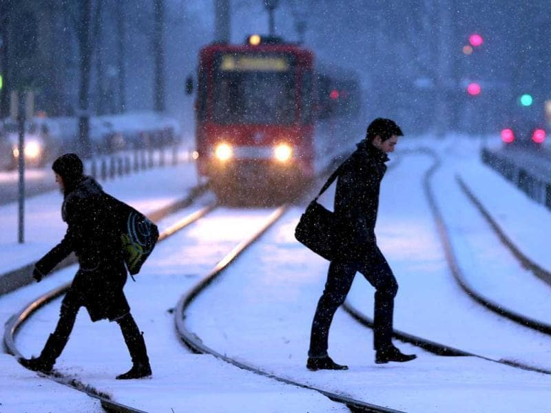 Pedestrians walk through the snow in Cologne, western Germany. (AFP)