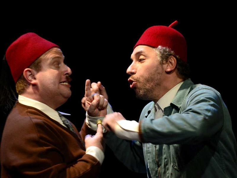 French actor Atmen Kelif (R), playing the Ali Baba character, performs with fellow actor Thomas Morris (L), playing Qassim, during the general of Ali Baba at the Theatre de la Criee in Marseille. (AFP)