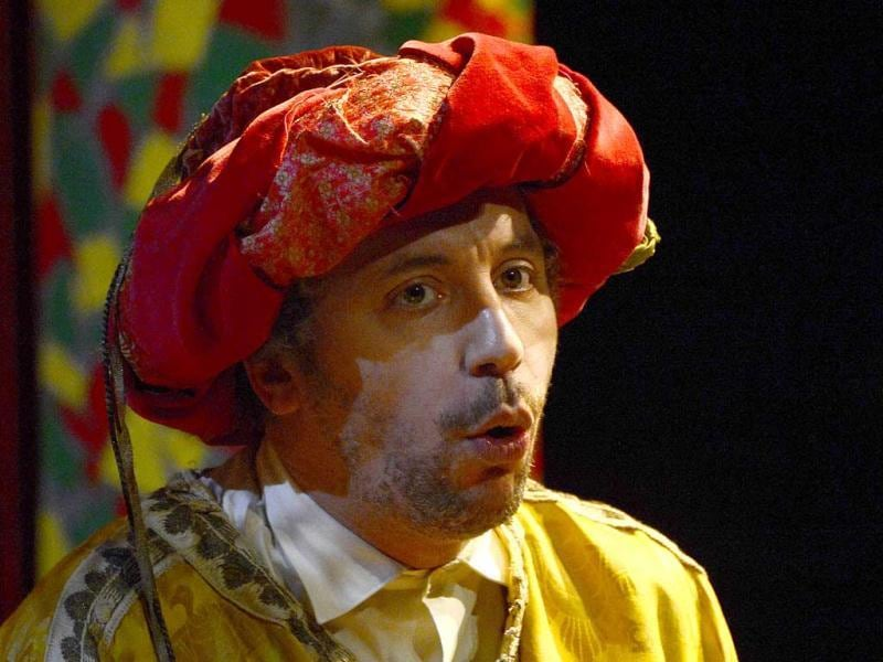 French actor Atmen Kelif, playing the Ali Baba character, performs during the general of Ali Baba at the Theatre de la Criee in Marseille. (AFP)