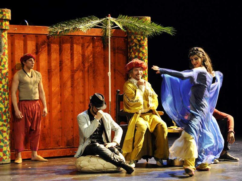 French actor Atmen Kelif (2nd R), playing the Ali Baba character, performs performs with Iranian dancers Sahar Dehghan (R), playing Morgiane, and Shahrokh Moshkin Ghalam (2nd L), playing Youssouf, during the general of Ali Baba at the Theatre de la Criee in Marseille. (AFP)