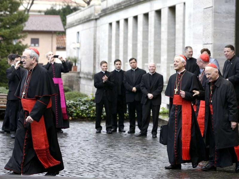From left, US Cardinals Justin Francis Rigali, Donald Wuerl, Timothy Dolan, Francis George and Roger Mahony leave the North American College to go to the Vatican's Domus Sanctae Martae, the Vatican hotel where the cardinals stay during the conclave, in Rome. The folded ballot is placed on a round plate and slid into an oval silver and gold urn. AP/Alessandra Tarantino