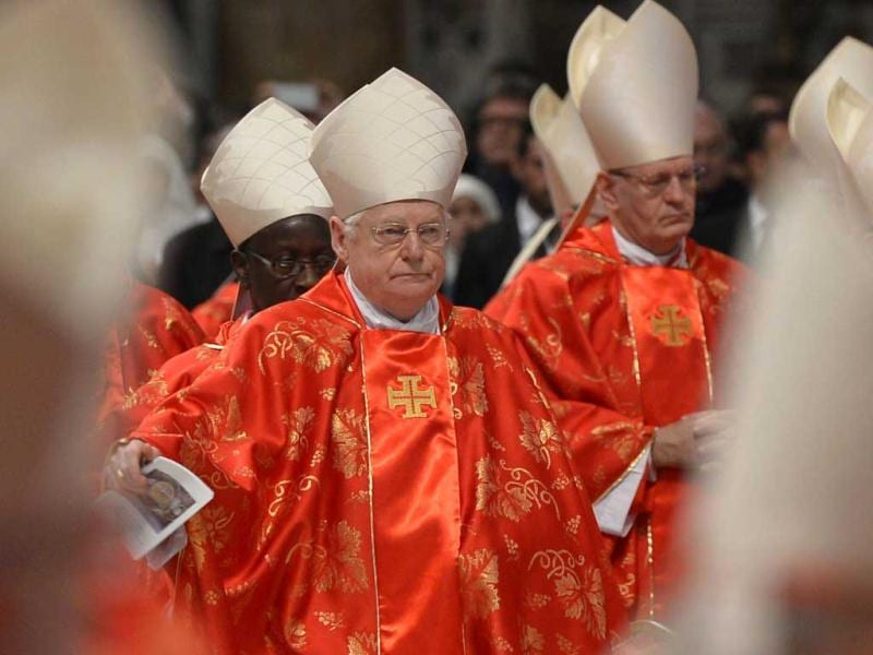 Italian cardinal Angelo Scola walks in procession for a grand mass in St Peter's Basilica ahead of a papal election conclave in St Peter's basilica at the Vatican. Up to four rounds of voting are allowed each day after the first day, and a two-thirds majority - 77 votes - is needed. If no one is elected after three days - by Friday afternoon - voting pauses for up to one day. AFP/Gabriel Bouys