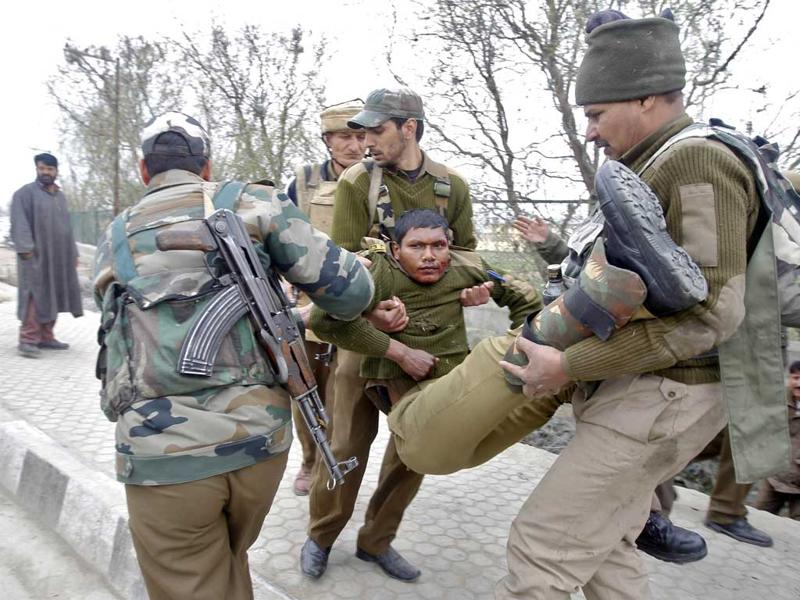 CRPF personnel carry their injured colleague to a hospital. REUTERS/Danish Ismail
