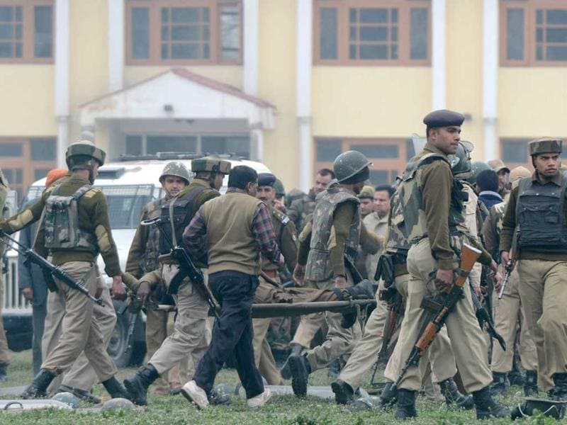 CRPF personnel carry away a fallen comrade on a stretcher. AFP/Tauseef Mustafa