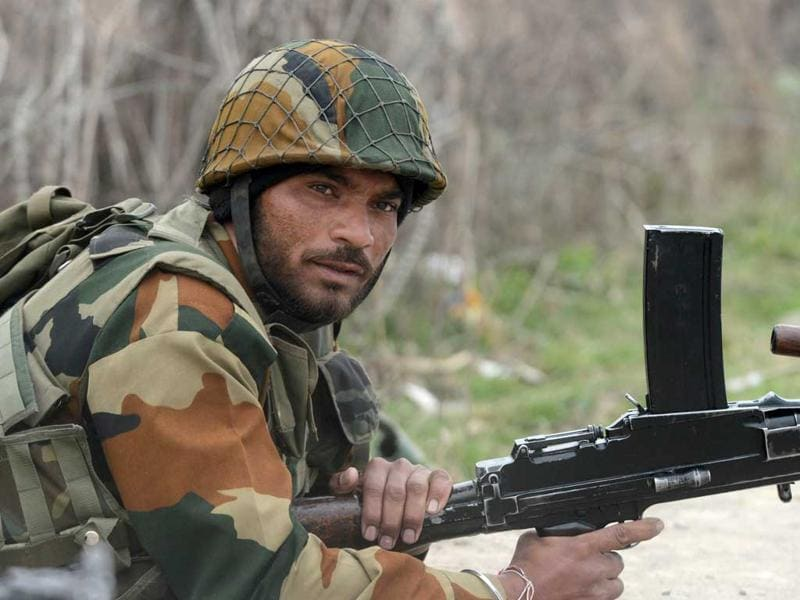 A CRPF jawan takes position with a Bren light machine gun outside the school. AFP/Tauseef Mustafa