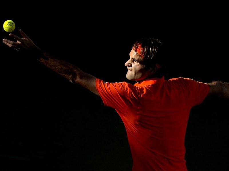 Roger Federer, of Switzerland, serves to Stanislas Wawrinka, of Switzerland, during their match at the BNP Paribas Open tennis tournament in Indian Wells, California. (AP Photo)