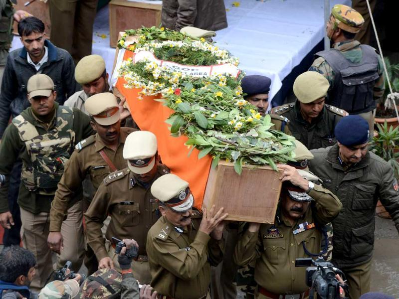 Police officers carry the coffin of a fallen comrade, who was killed in an ambush, following a wreath laying ceremony in Srinagar. Pakistan has strongly rejected an accusation from India that militants who killed five CRPF jawans came from across the de facto border. AFP PHOTO