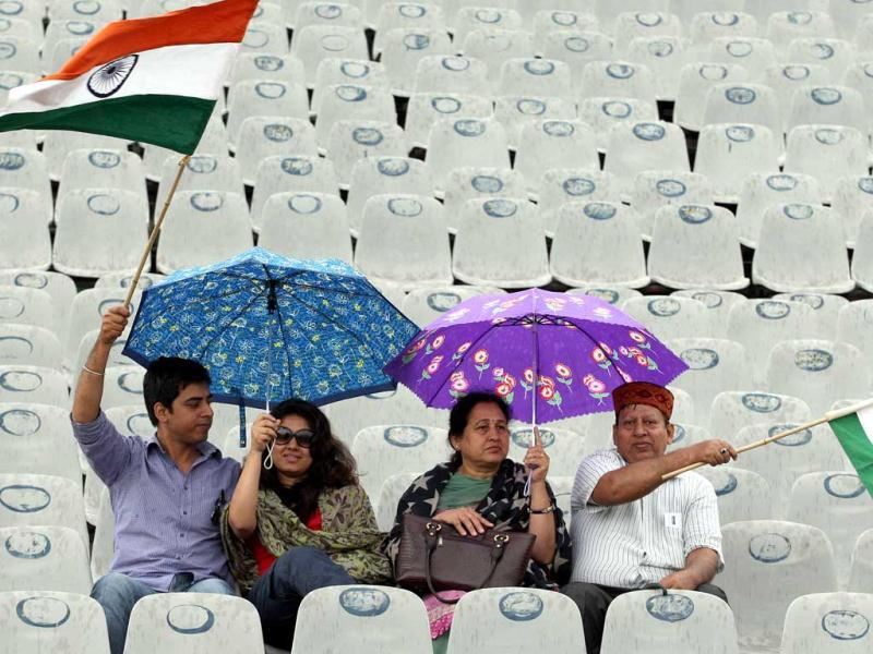 Cricket fans waiting for the weather to clear on the first day of 3rd Test match at PCA stadium in Mohali. Gurpreet Singh/HT