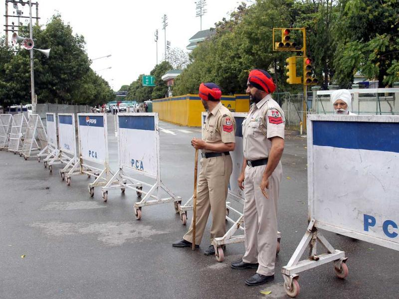 Punjab police personnel barricading PCA stadium on the first day of the third Test match in Mohali. Gurpreet Singh/HT