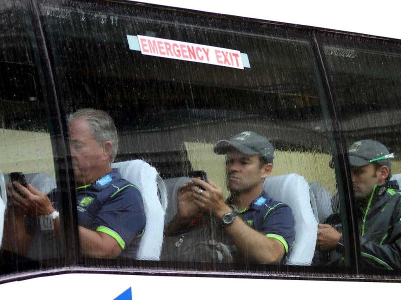 Steven Smith and members of the Australian team leave the stadium after the first day's play of the third Test in Mohali was abandoned due to rain in Mohali. Gurpreet Singh/HT