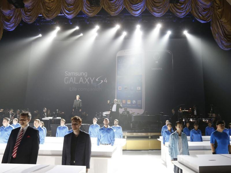 Workers prepare to display Samsung Electronics Co's latest Galaxy S4 phone after its launch at the Radio City Music Hall in New York. Reuters photo