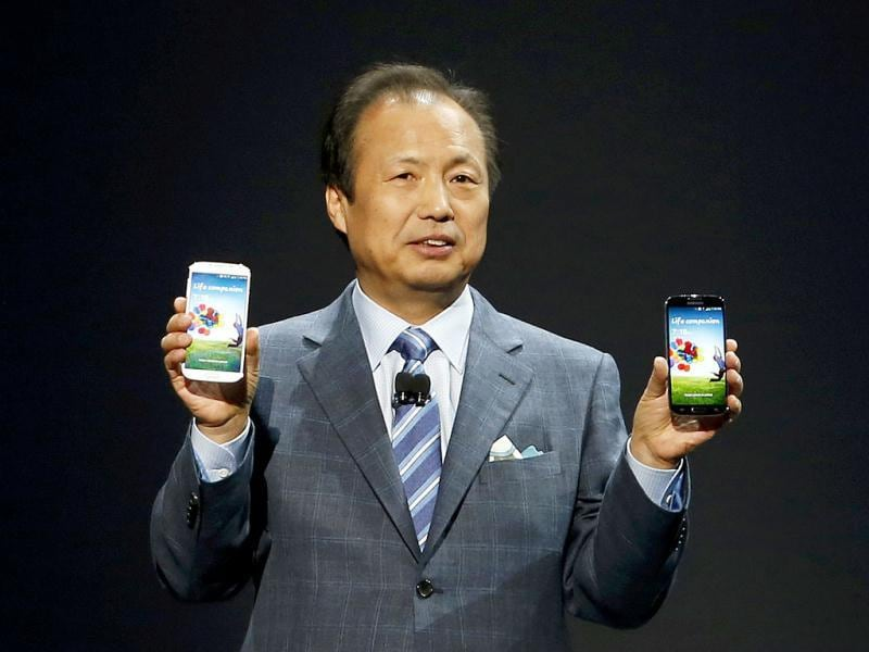 JK Shin, president and head of IT and mobile communication division, holds up Samsung Electronics Co's latest Galaxy S4 phones during its launch at the Radio City Music Hall in New York. Reuters photo