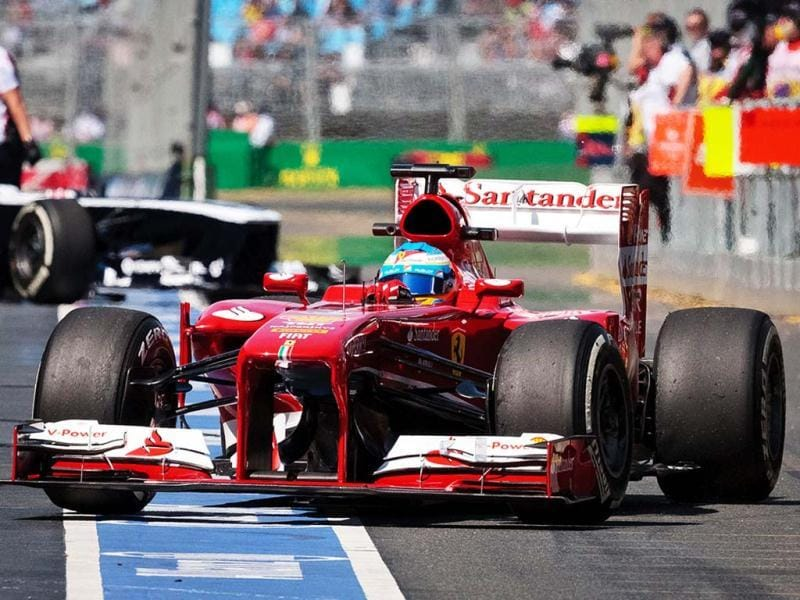 Fernando Alonso of Spain steers his car in the pit lane during the first practice session for Sunday's Australian Formula One Grand Prix at Albert Park in Melbourne, Australia. (AP Photo)