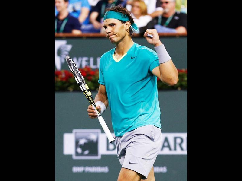 Nadal of Spain celebrates defeating Switzerland's Federer in their men's singles quarterfinal match at the BNP Paribas Open ATP tennis tournament in Indian Wells. (Reuters)
